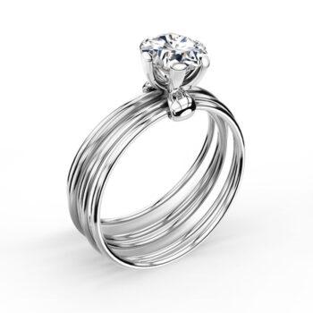 Κομψό λευκόχρυσο μονόπετρο δαχτυλίδι μπριγιάν